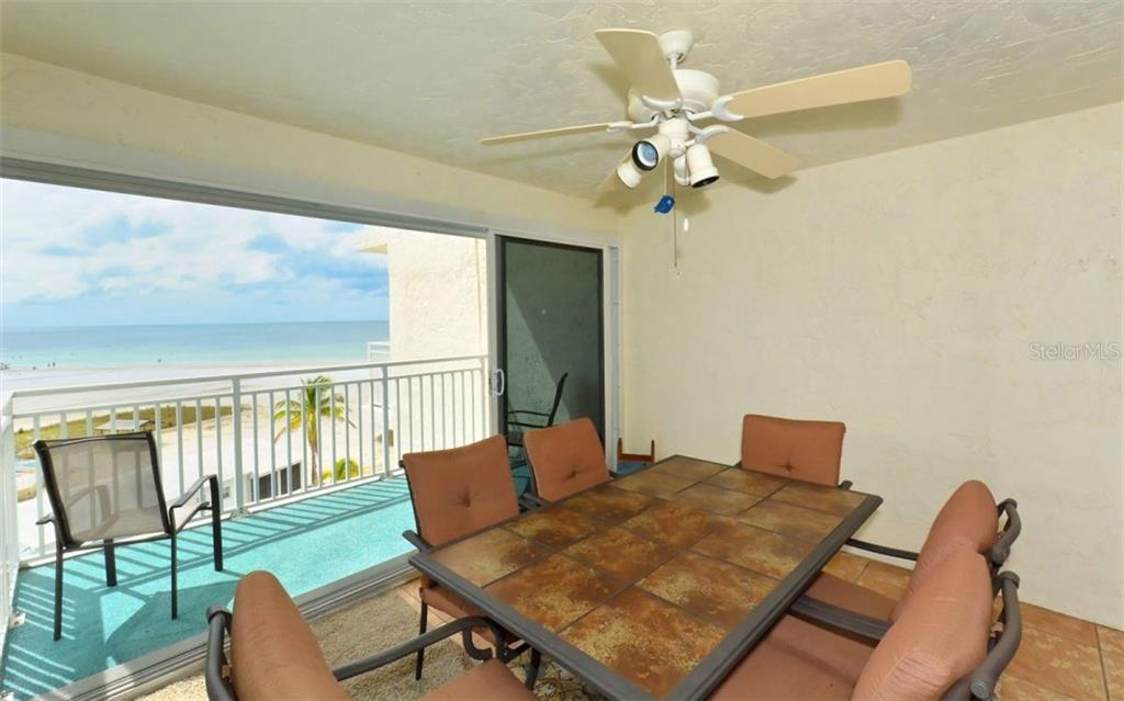Enclosed balcony with sliders to open balcony - Single Family Home for sale at 5830 Midnight Pass Rd #504, Sarasota, FL 34242 - MLS Number is A4166623