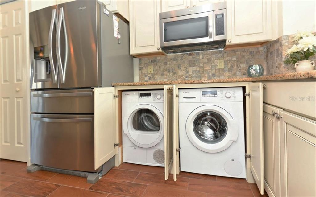 In unit laundry - Condo for sale at 5830 Midnight Pass Rd #504, Sarasota, FL 34242 - MLS Number is A4166623