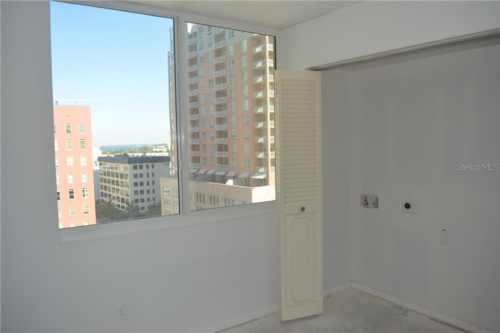 2nd Bedroom with partial water view and washer/dryer hook-up in the closet - Condo for sale at 101 S Gulfstream Ave #11a, Sarasota, FL 34236 - MLS Number is A4168207