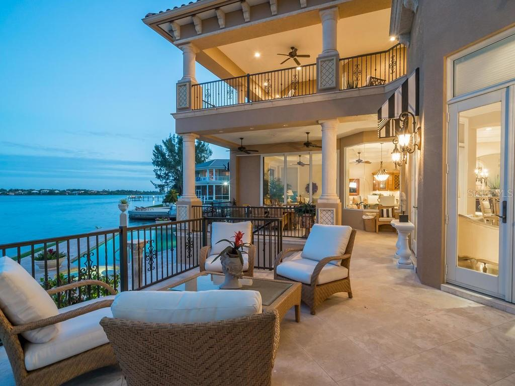 Main level terrace with swimming pool and bay views - Single Family Home for sale at 640 Rountree Dr, Longboat Key, FL 34228 - MLS Number is A4169177