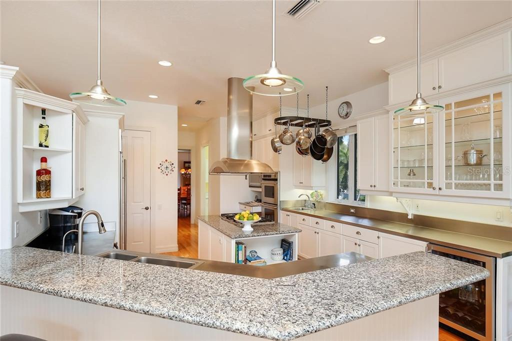 White Cabinetry and Stainless Steel Countertops and Appliances in this Chef's Arena! - Single Family Home for sale at 722 Siesta Dr, Sarasota, FL 34242 - MLS Number is A4169257