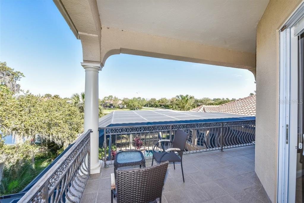 Lovely views from the veranda - Single Family Home for sale at 3313 Founders Club Dr, Sarasota, FL 34240 - MLS Number is A4169443