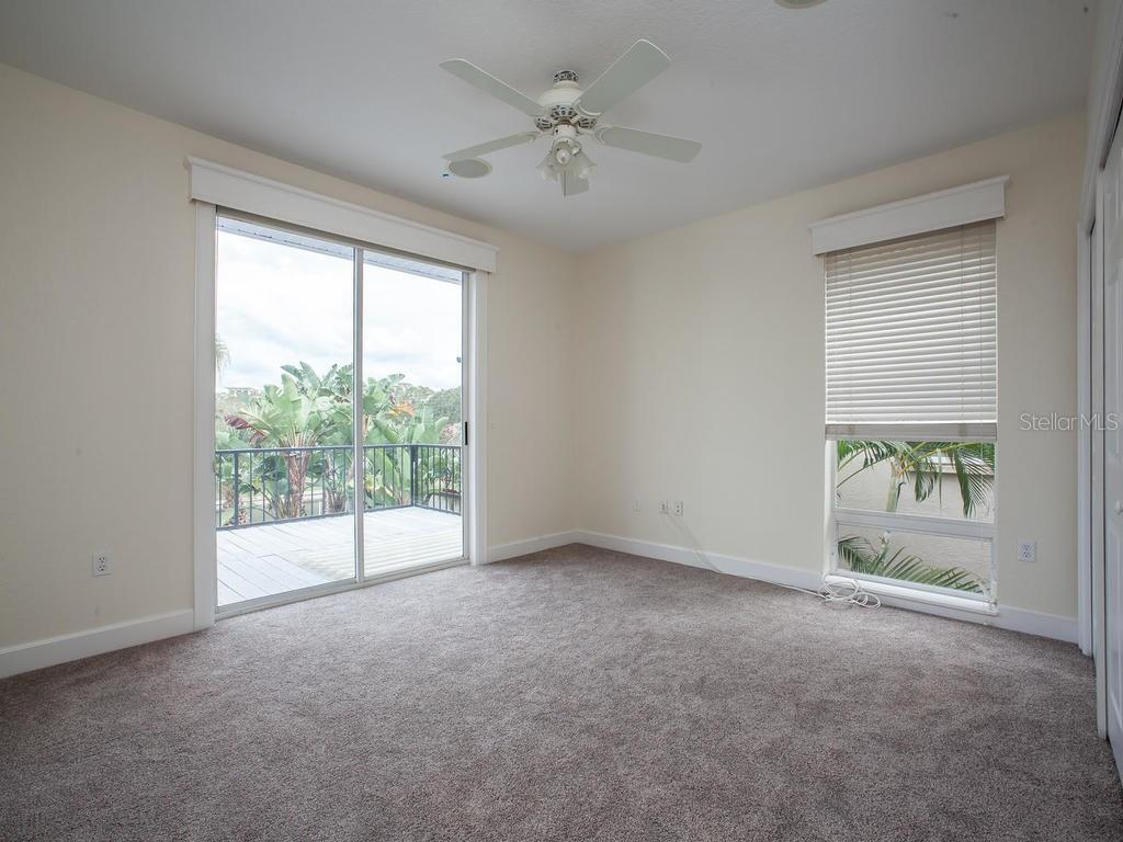2nd bedroom with sliders to balcony - Single Family Home for sale at 4789 Higel Ave, Sarasota, FL 34242 - MLS Number is A4169949