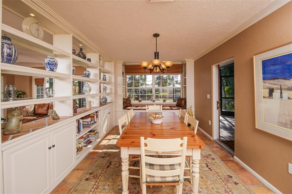 Dining area with window seat storage and water views. - Single Family Home for sale at 5281 Cape Leyte Way, Sarasota, FL 34242 - MLS Number is A4171478