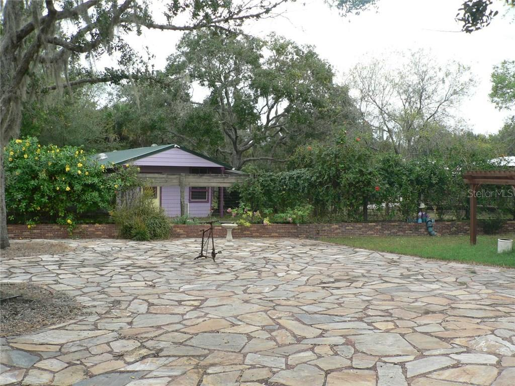 Back Yard View to Work Shop - Single Family Home for sale at 16314 Golf Course Rd, Parrish, FL 34219 - MLS Number is A4171555