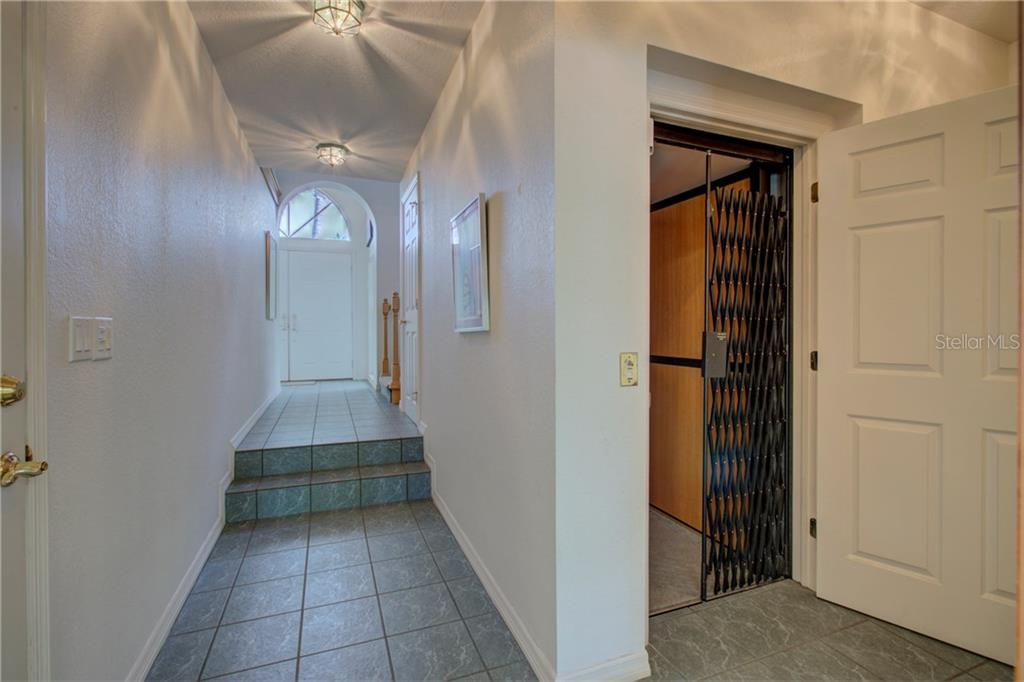 Stairs to dining room - Single Family Home for sale at 569 Juan Anasco Dr, Longboat Key, FL 34228 - MLS Number is A4173741