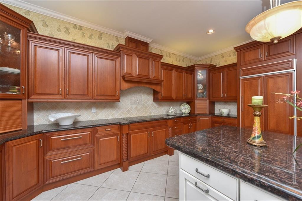 High end cabinets, wine cooler, under counter 2-drawer refrigerator, ice make,vfood warmer, 2 cabinet garages for appliances, 7.5X4.5 pantry.  The chef will LOVE this kitchen. - Single Family Home for sale at 4298 Boca Pointe Dr, Sarasota, FL 34238 - MLS Number is A4176372