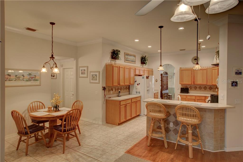 Wonderful breakfast nook with walk in pantry behind that.   Tile kick plate which makes it easy to clean.  Beautiful tile selection - Single Family Home for sale at 4516 Useppa Dr, Bradenton, FL 34203 - MLS Number is A4178602