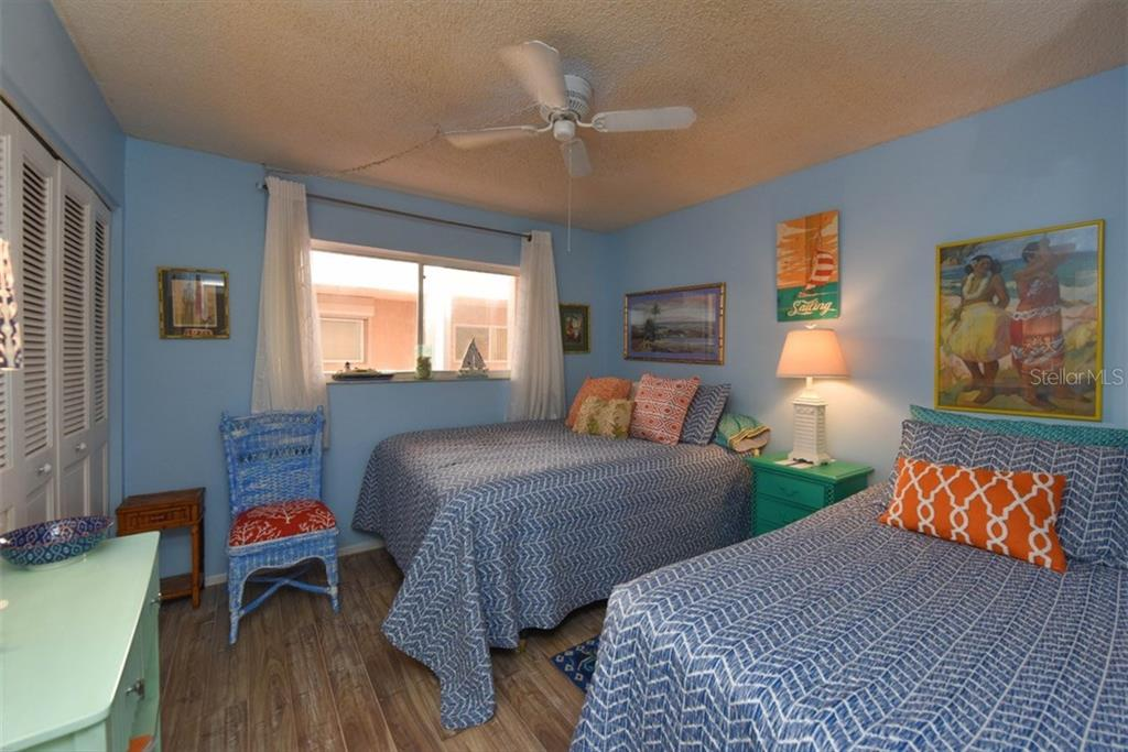 Guest bedroom with one queen bed and one twin bed.  Waiting for your friends to enjoy your Paradise lifestyle. - Condo for sale at 1330 Glen Oaks Dr E #275d, Sarasota, FL 34232 - MLS Number is A4178649