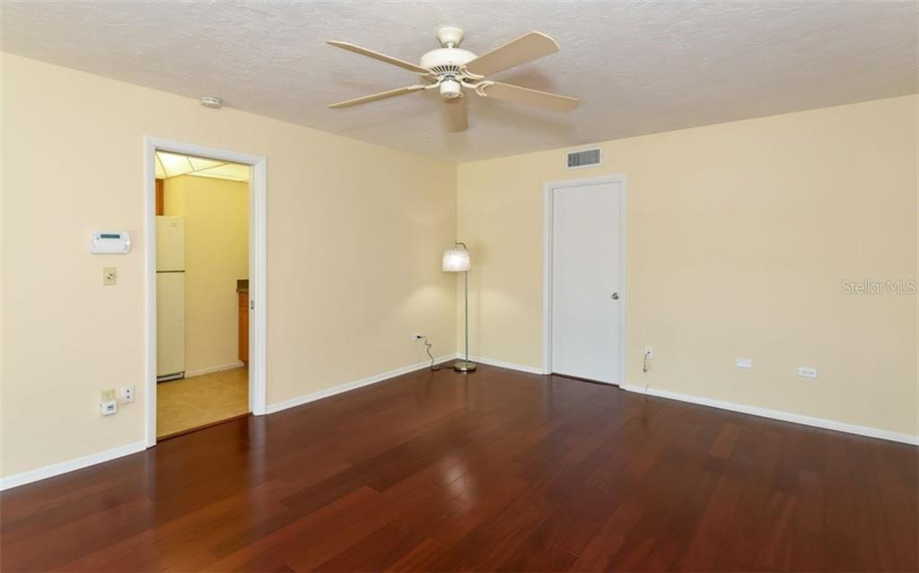 Living/Dining area with wood flooring - Condo for sale at 133 Avenida Messina #4, Sarasota, FL 34242 - MLS Number is A4179566