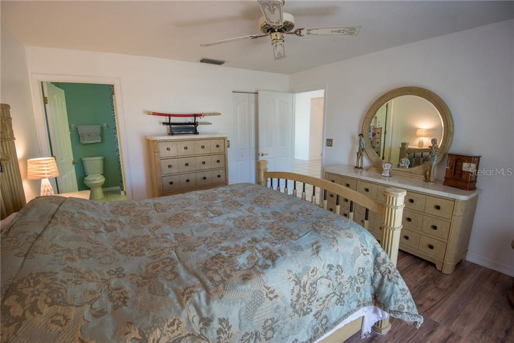 Master bedroom - Single Family Home for sale at 7718 36th Ln E, Sarasota, FL 34243 - MLS Number is A4181555