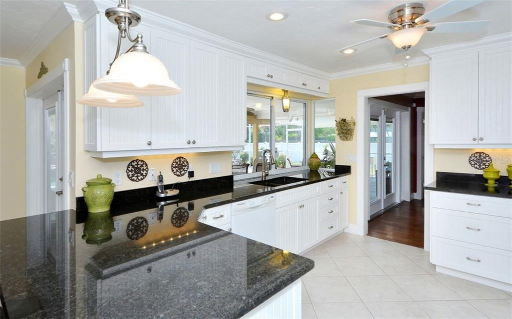 Enjoy cooking in this pretty kitchen, newer cabinets, appliances and granite counters, pass thru to the pool. - Single Family Home for sale at 6239 Hollywood Blvd, Sarasota, FL 34231 - MLS Number is A4182790