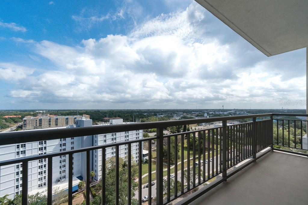 A view of the pool and guest suites. - Condo for sale at 800 N Tamiami Trl #1201, Sarasota, FL 34236 - MLS Number is A4184297