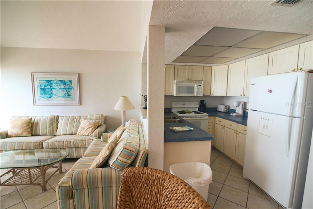 Living rm/Kitchen - Condo for sale at 100 73rd St #202a, Holmes Beach, FL 34217 - MLS Number is A4184505