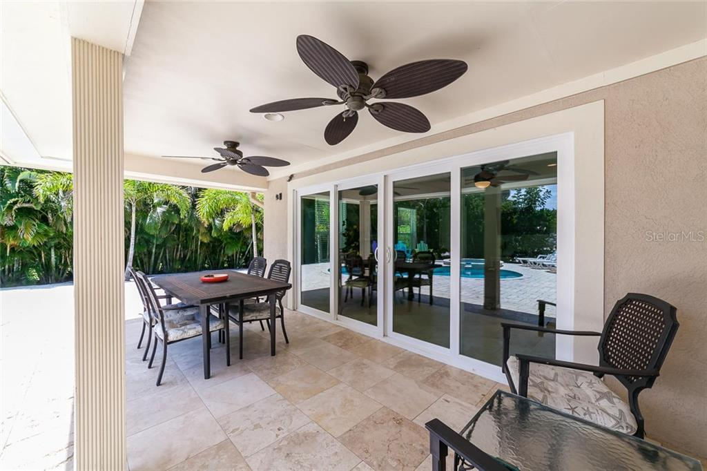The large covered porch could easily be screened if you like. - Single Family Home for sale at 413 Bay Palms Dr, Holmes Beach, FL 34217 - MLS Number is A4184679