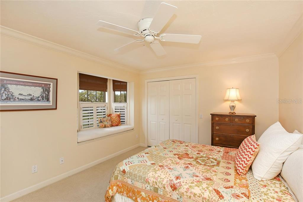 Bedroom #Three with lovely window seat and Jack-n-Jill bathroom shared with Bedroom #Four. - Single Family Home for sale at 3765 Beneva Oaks Blvd, Sarasota, FL 34238 - MLS Number is A4185879