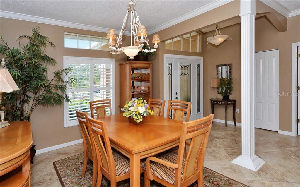 Dining area and entry. - Single Family Home for sale at 4121 Via Mirada, Sarasota, FL 34238 - MLS Number is A4186485