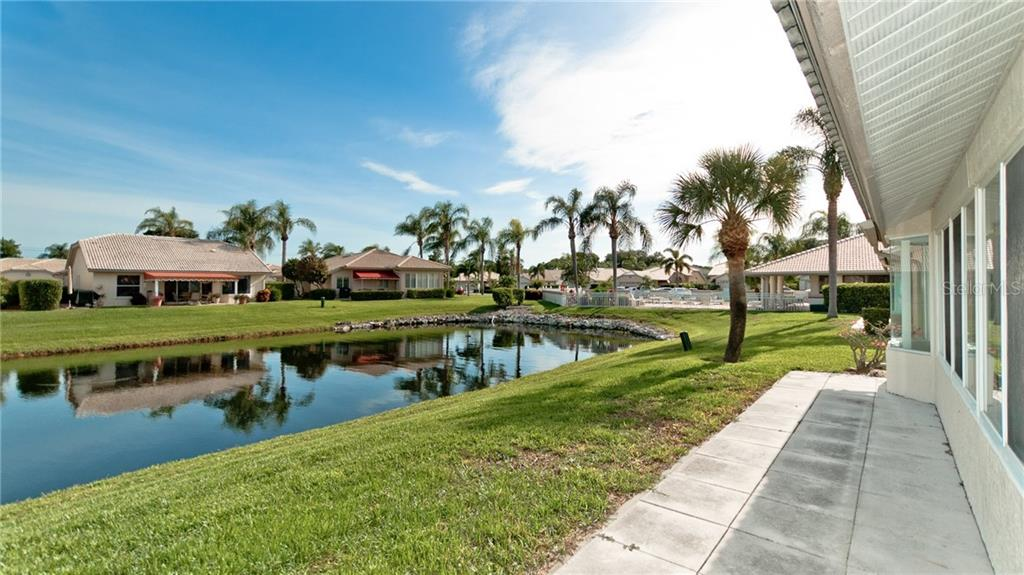 View from the back patio, clubhouse and community pool are just steps away! - Single Family Home for sale at 4517 Galloway Blvd, Bradenton, FL 34210 - MLS Number is A4187598