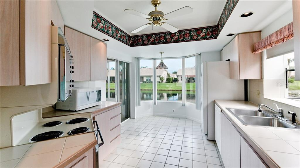 Eat-in kitchen aquarium window, newer refrigerator. - Single Family Home for sale at 4517 Galloway Blvd, Bradenton, FL 34210 - MLS Number is A4187598