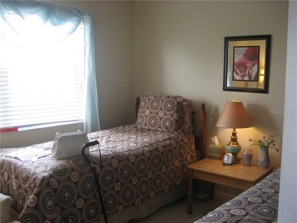 Second bedroom has huge windows - Condo for sale at 3820 Ironwood Ln #606i, Bradenton, FL 34209 - MLS Number is A4187664