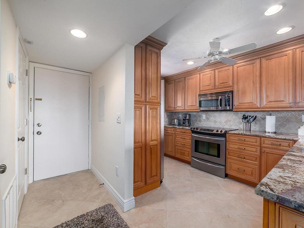 Entrance and Kitchen - Condo for sale at 6236 Midnight Pass Rd #406, Sarasota, FL 34242 - MLS Number is A4188093