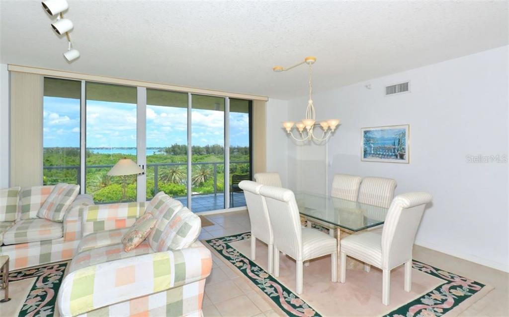 Breakfast nook in kitchen where Bay view and sunrises can be appreciated. - Condo for sale at 1800 Benjamin Franklin Dr #b507, Sarasota, FL 34236 - MLS Number is A4188540