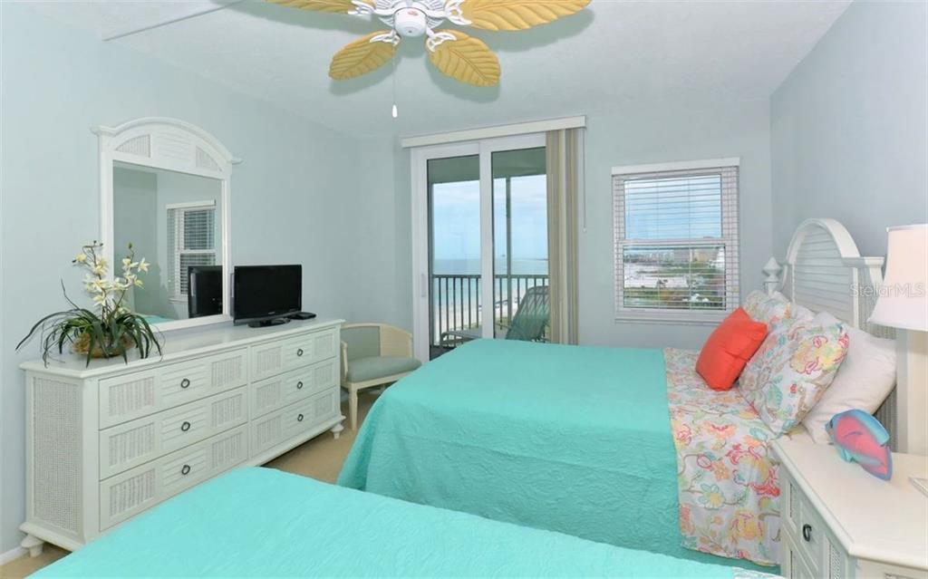 Master bedroom with sliders to covered terrace - Condo for sale at 6300 Midnight Pass Rd #806, Sarasota, FL 34242 - MLS Number is A4189340
