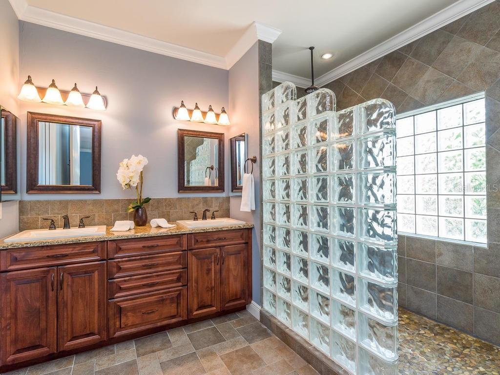 Master bath includes walk-in shower with pebble flooring, built-in seat and rain head. - Single Family Home for sale at 1884 Grove St, Sarasota, FL 34239 - MLS Number is A4189365