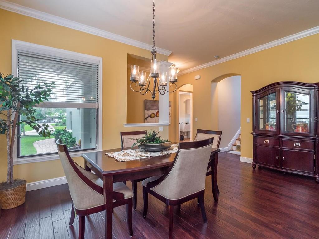 Dining area over wood floors, lovely chandelier and lots of natural light. - Single Family Home for sale at 1884 Grove St, Sarasota, FL 34239 - MLS Number is A4189365