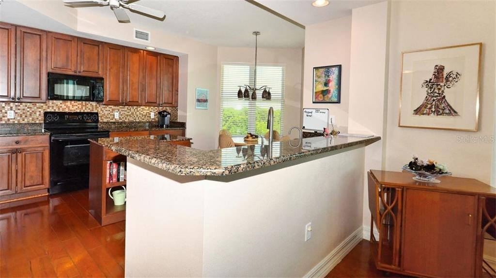 Kitchen with breakfast bar - Condo for sale at 409 N Point Rd #601, Osprey, FL 34229 - MLS Number is A4189564