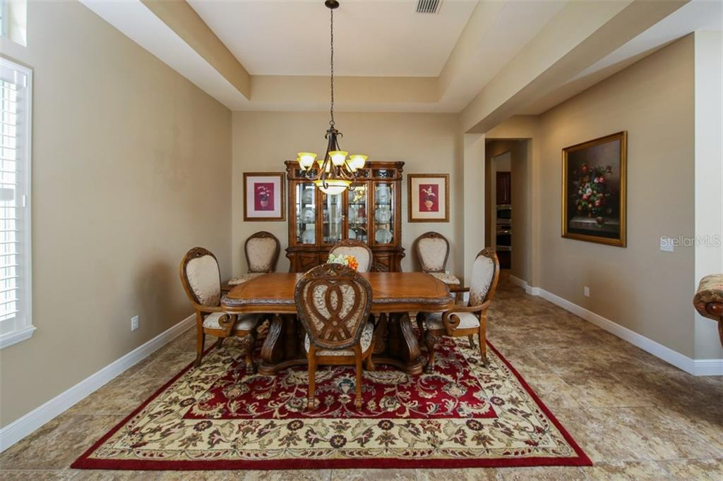 Large Formal Dining Area For All Your Special Occassions - Single Family Home for sale at 5770 Rock Dove Dr, Sarasota, FL 34241 - MLS Number is A4190439