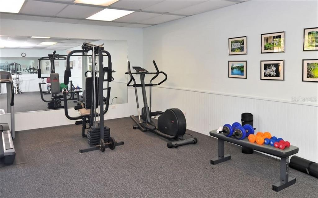 Fitness facility in Clubhouse - Condo for sale at 104 Woodland Pl #104, Osprey, FL 34229 - MLS Number is A4190676