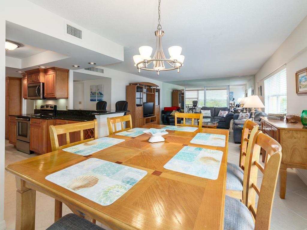 Dining, Kitchen, looking into Liv Rm, enclosed lanai with City view - Condo for sale at 1750 Benjamin Franklin Dr #5g, Sarasota, FL 34236 - MLS Number is A4192160