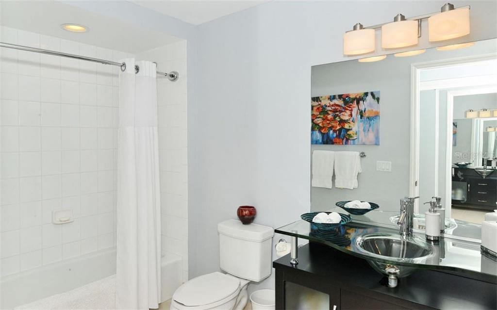 UPDATED 2ND BATHROOM WITH TUB. - Condo for sale at 100 Central Ave #h716, Sarasota, FL 34236 - MLS Number is A4193586