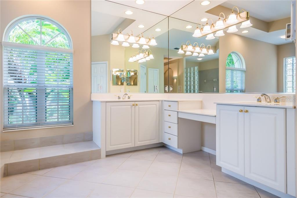 Separate vanities in the master bath. - Single Family Home for sale at 8019 Collingwood Ct, University Park, FL 34201 - MLS Number is A4193802