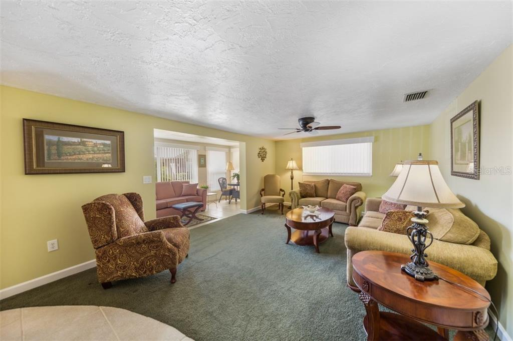 Living room into lanai view - Condo for sale at 6140 Midnight Pass Rd #c-9, Sarasota, FL 34242 - MLS Number is A4195879
