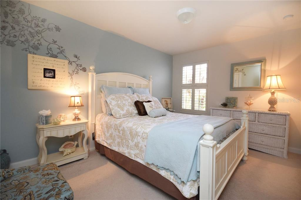 Guest Bedroom has neutral carpeting - Villa for sale at 2127 Burgos Dr, Sarasota, FL 34238 - MLS Number is A4195921