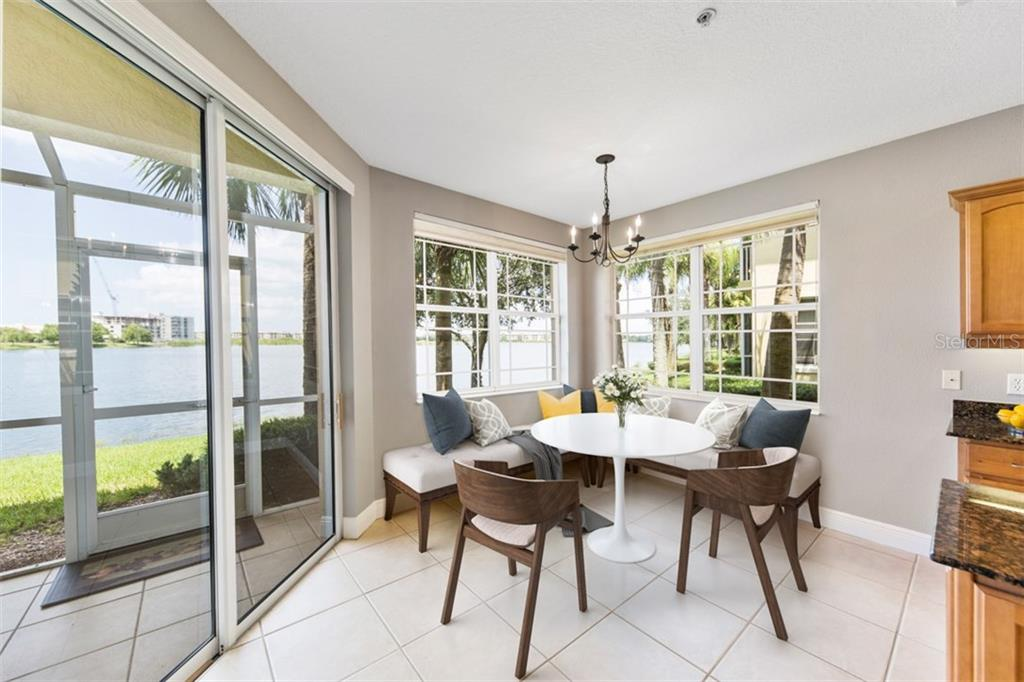 Staged casual eating space in kitchen overlooking the lake. - Condo for sale at 6415 Moorings Point Cir #102, Lakewood Ranch, FL 34202 - MLS Number is A4196054