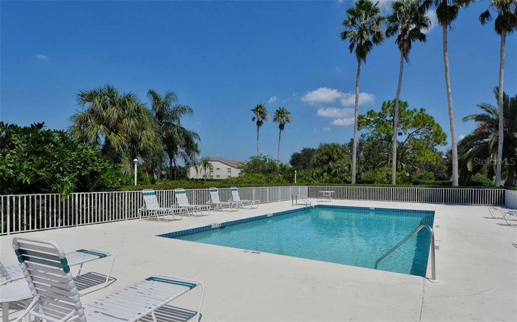 Heated community pool for the condo complex. - Condo for sale at 9570 High Gate Dr #1712, Sarasota, FL 34238 - MLS Number is A4196327