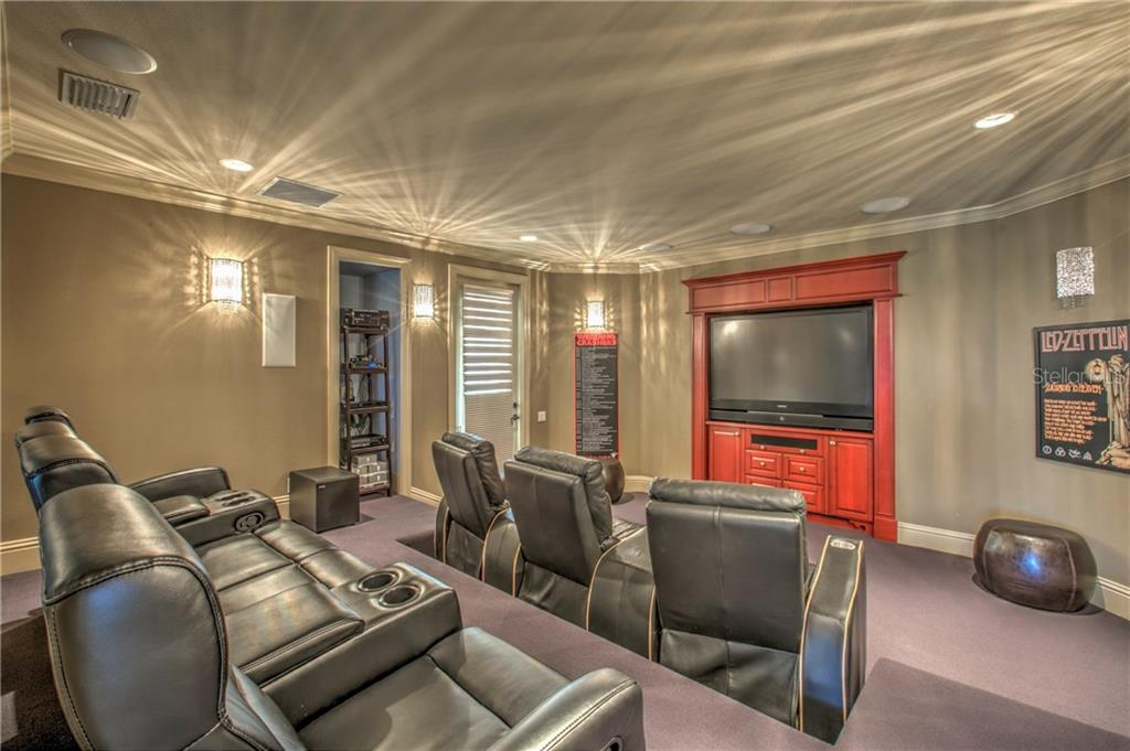 Theater room with seating for 7. Built in surround sound and movie theater reclining chairs. - Single Family Home for sale at 548 Fore Dr, Bradenton, FL 34208 - MLS Number is A4196590