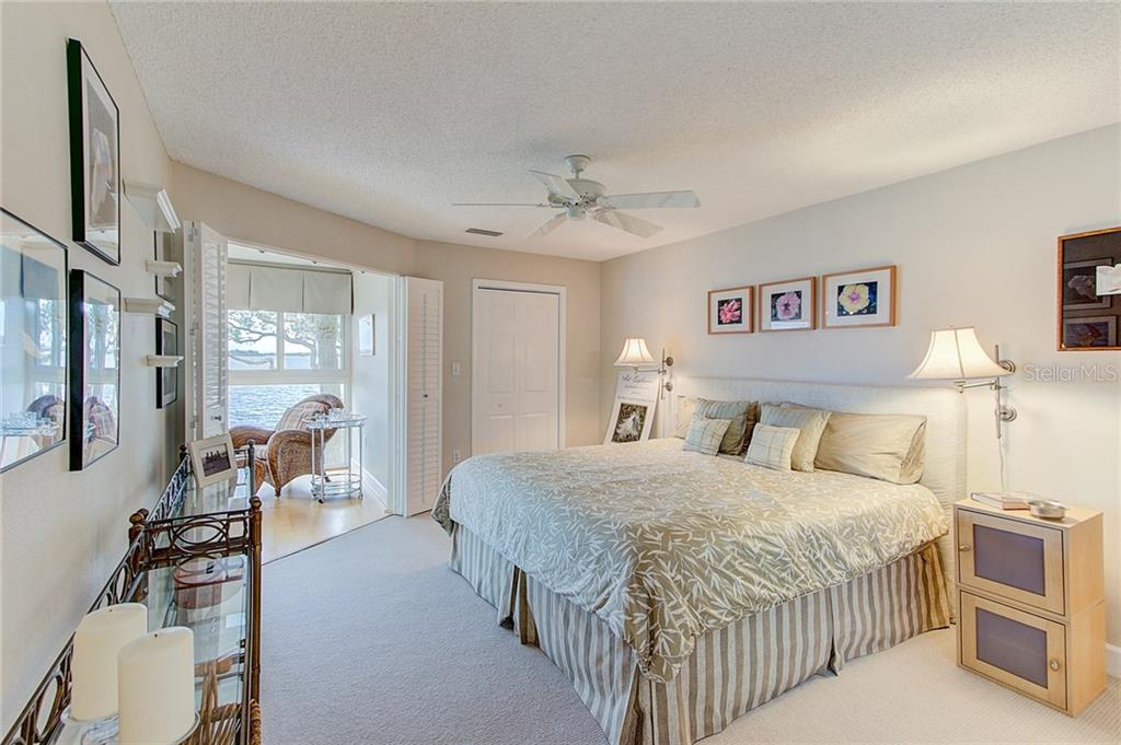Spacious Master Bedroom with breathtaking water views - Condo for sale at 600 Manatee Ave #236, Holmes Beach, FL 34217 - MLS Number is A4197636