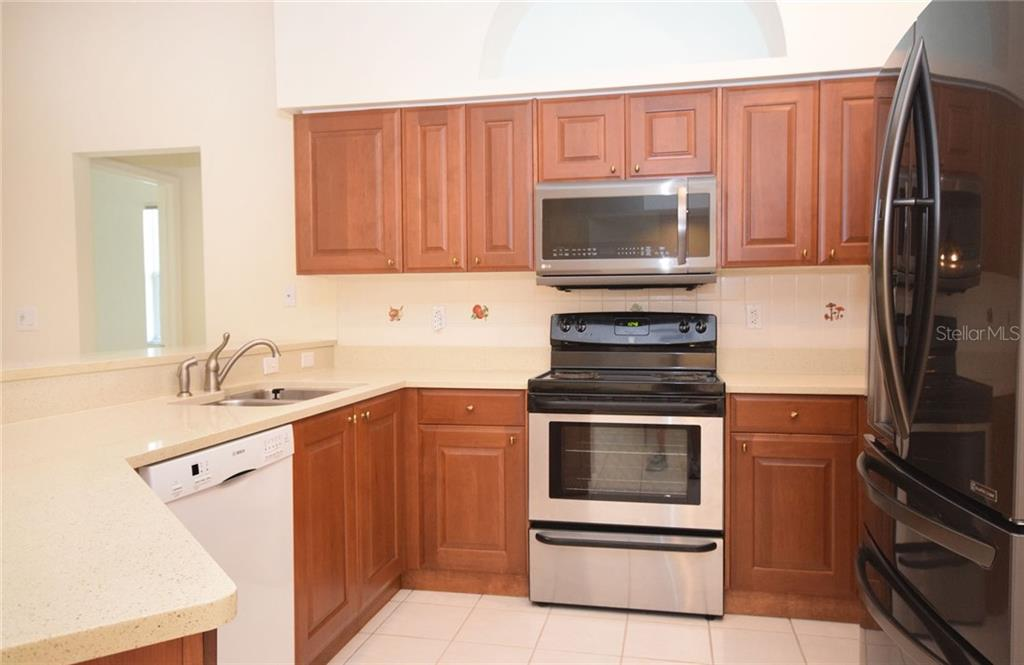 Kitchen - Single Family Home for sale at 9520 Hawksmoor Ln, Sarasota, FL 34238 - MLS Number is A4197662