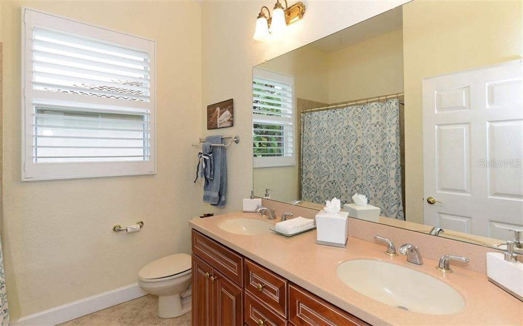2nd Bathroom - Single Family Home for sale at 9919 Portside Ter, Bradenton, FL 34212 - MLS Number is A4197815