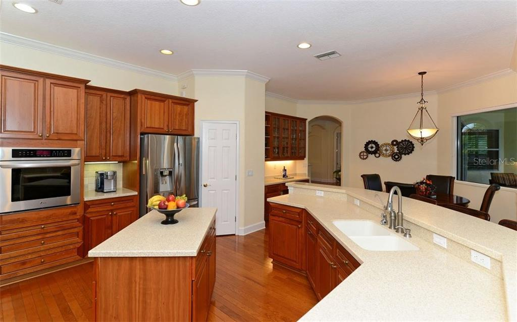 Kitchen toward dinette - Single Family Home for sale at 9919 Portside Ter, Bradenton, FL 34212 - MLS Number is A4197815