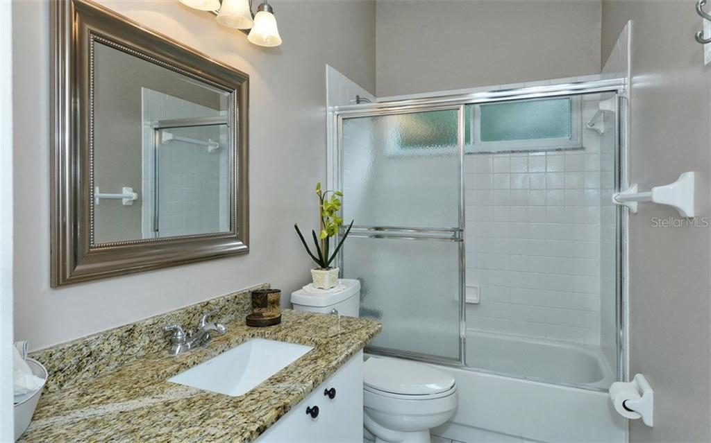 Guest bath with granite counter top. - Single Family Home for sale at 9571 Knightsbridge Cir, Sarasota, FL 34238 - MLS Number is A4197972
