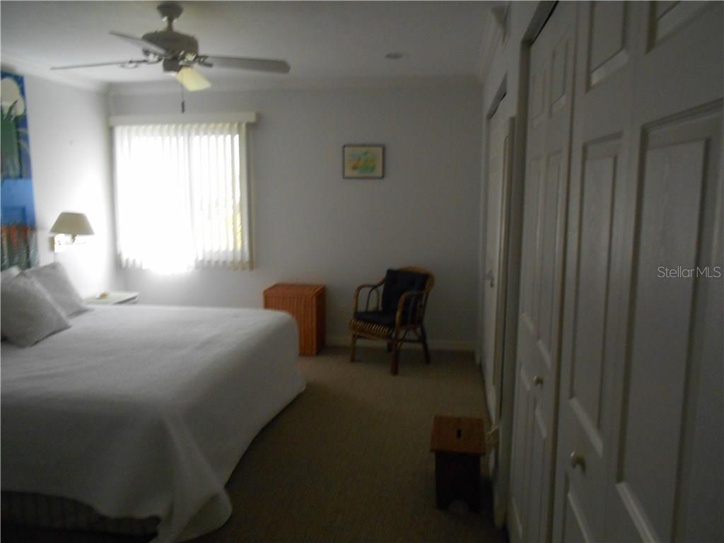 Bedroom 2 - Condo for sale at 5661 Midnight Pass Rd #403, Sarasota, FL 34242 - MLS Number is A4198451