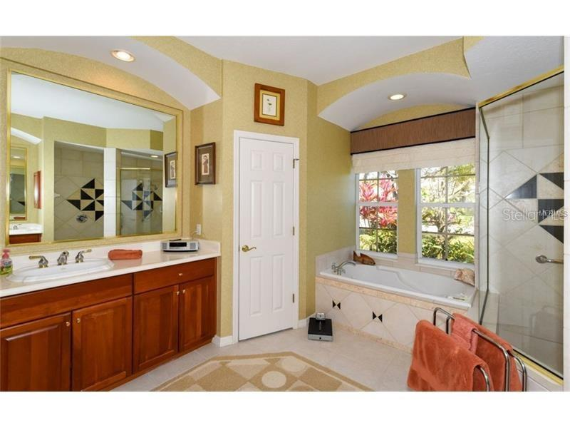 Master Bathroom With Jetted Tub, Shower and Dual Sinks! - Single Family Home for sale at 6910 Treymore Ct, Sarasota, FL 34243 - MLS Number is A4198957