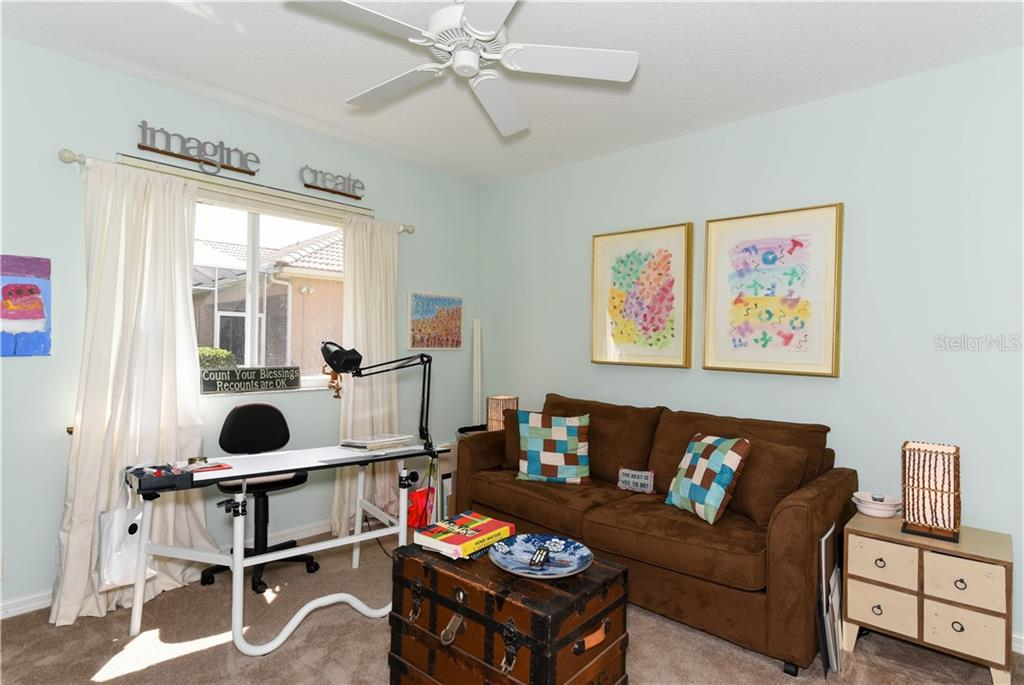 Third bedroom being used as a studio. - Single Family Home for sale at 4887 Carrington Cir, Sarasota, FL 34243 - MLS Number is A4199511