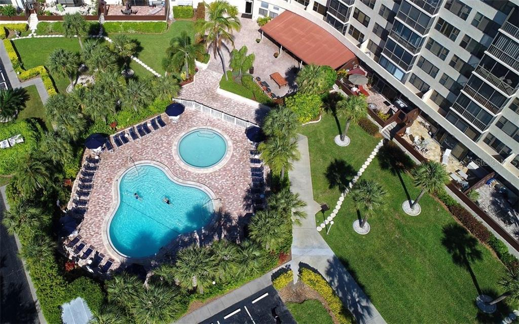 Aerial view looking down at community amenities - Condo for sale at 5855 Midnight Pass Rd #328, Sarasota, FL 34242 - MLS Number is A4200358