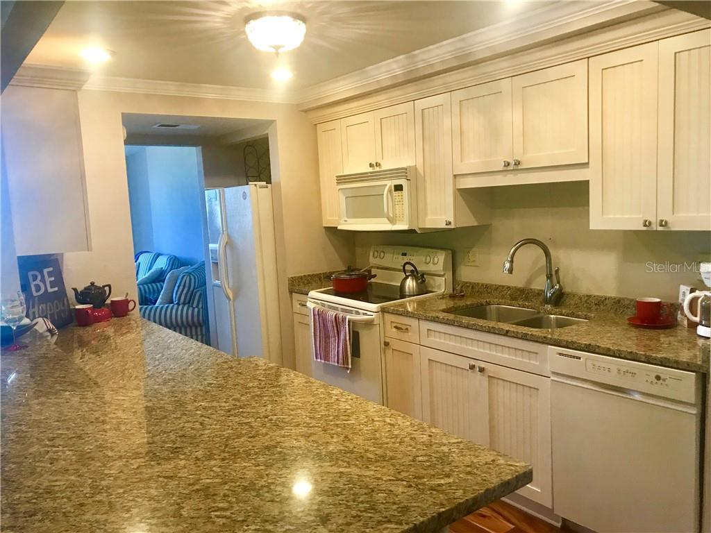 Updated Kitchen with Granite counters - Condo for sale at 5855 Midnight Pass Rd #328, Sarasota, FL 34242 - MLS Number is A4200358